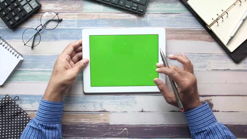 Top view of businessman using digital tablet on office desk  | Shutterstock HD Video #1060980592