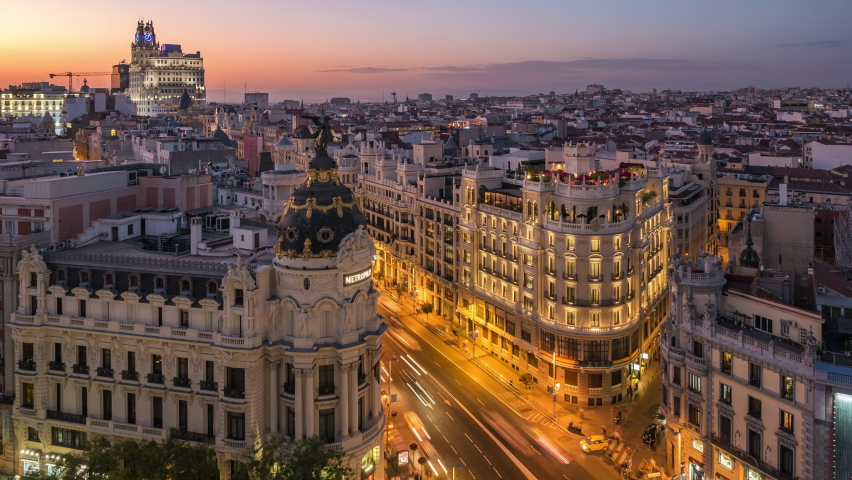 Time lapse view of sunset over historic buildings and traffic on Gran Via street in Madrid, the capital and largest city in Spain. Royalty-Free Stock Footage #1060980760