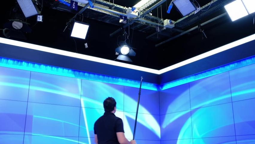 Adjusting professional lighting in studio | Shutterstock HD Video #1060987003