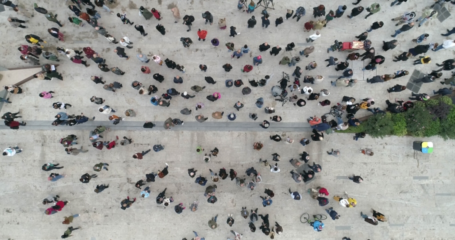 Crowd of people overhead drone shot