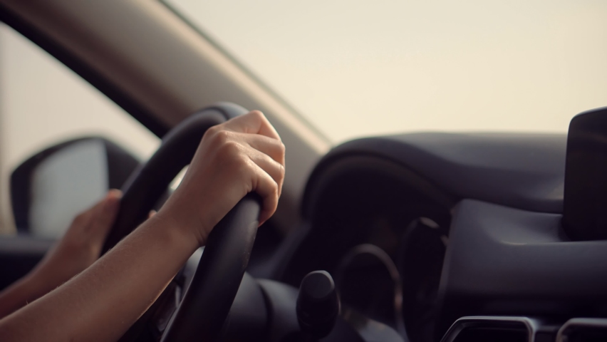 Woman Driver Hand On Car Steering Wheels.Using Windshield Wiper And Washer Controls In Car Holding Wheel.Woman Driver Turning Steering Wheel In Car.Female Travelling On Automobile.Woman Driving Auto. Royalty-Free Stock Footage #1060990795
