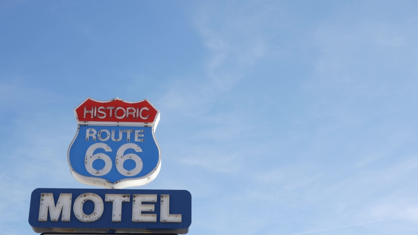 Motel retro sign on historic route 66 famous travel destination, vintage symbol of road trip in USA. Iconic lodging signboard in Arizona desert. Old-fashioned neon signage. Classic tourist landmark.