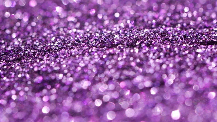 Neon fluorescent violet color glitter, shimmer falling down with light sparkling | Shutterstock HD Video #1060994152