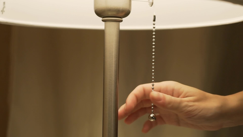 Close-up of a Woman's Hand Turning Off a Floor Lamp. Macro Hand and Floor Lamp. Turning Off The Light.