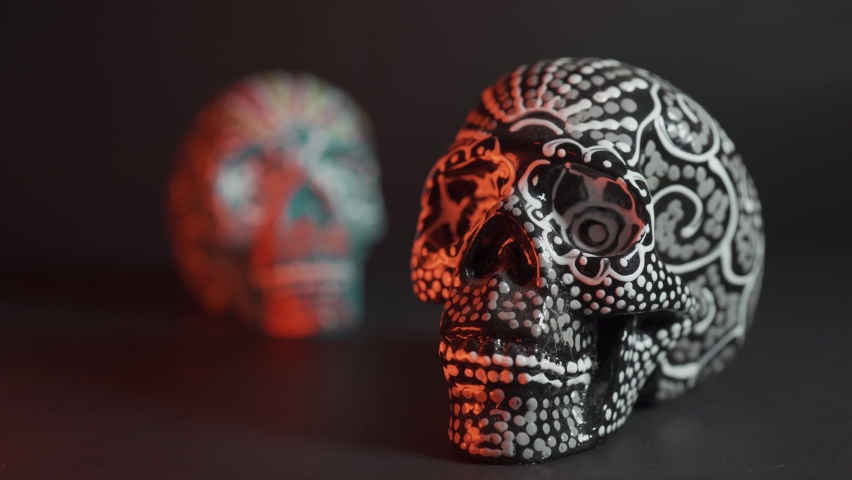 Painted skull for the Day of the Dead in red light with smoke, Mexican tradition | Shutterstock HD Video #1060997386