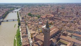 Panoramic aerial drone view of Verona, Italy. The drone moves away filming a video of the panorama of the old city and the Adige river. Video in 4K