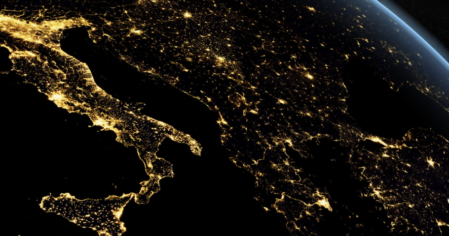 View of Italy at night in the earth planet rotating from space