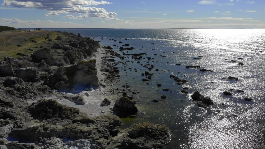 Beautiful Rauk Beach With Sun Reflecting On Water Surface, Forward Aerial | Shutterstock HD Video #1061007778