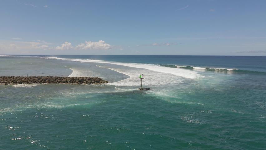 Fasting drone shot of the Jetty outside Hagatna Boat Basin Guam | Shutterstock HD Video #1061007793