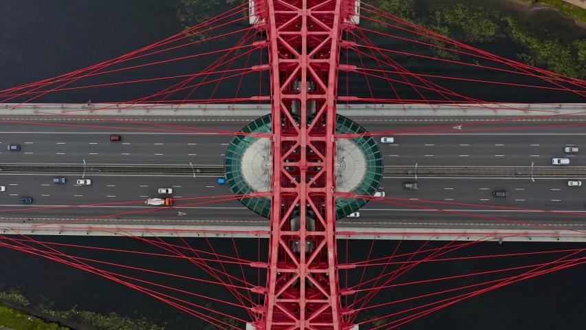 AERIAL SLOWMOTION static scene top-down view of the car on the red highway bridge over the river, Moscow, Russia | Shutterstock HD Video #1061008318