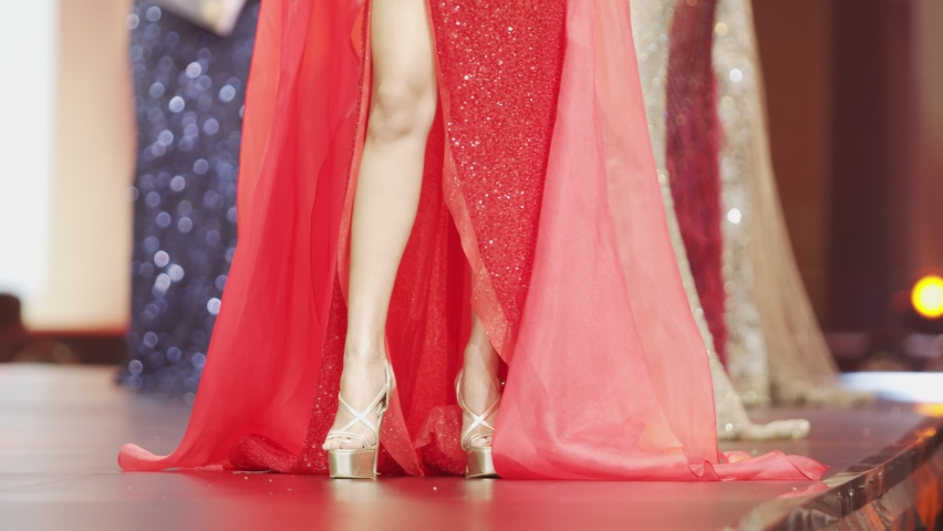 Fashion Show Catwalk in Beautiful Luxury Evening Gown on ramp Stage with Lighting. All Miss Beauty contest wear high heel shoes. 4k slow motion lower parts unrecognize persons | Shutterstock HD Video #1061009272