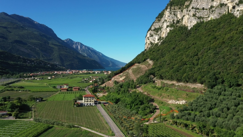 Riva del Garda, Torbole, Lake Garda, Italy. Panorama from left to right at high altitude. Slow motion in flight  | Shutterstock HD Video #1061009482