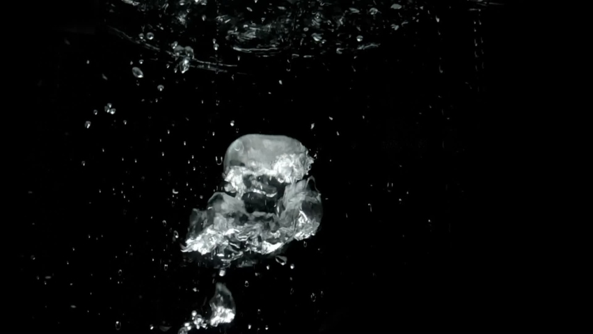 Air bubbles in water in super slow motion isolated on black background. Underwater Bubbles in slow motion Close up view shot. Super Slow Motion Detail Shot of Air Bubble underwater. Royalty-Free Stock Footage #1061015563