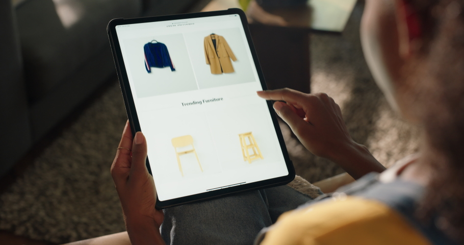 Woman using tablet shopping online buying clothes browsing online store e commerce on mobile technology | Shutterstock HD Video #1061018233