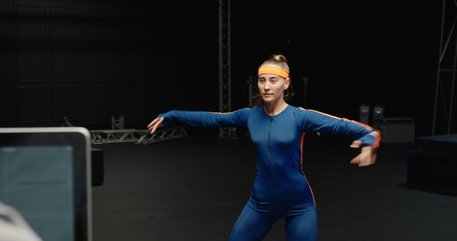 Woman wearing motion capture suit dancing in studio ballet dancer girl wearing mo-cap suit for 3d character animation for virtual reality technology | Shutterstock HD Video #1061018548