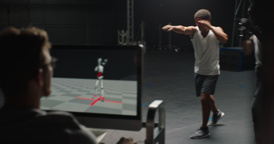 Actor wearing motion capture suit rehearsing martial arts with instructor teaching fighting moves mo-cap suit for 3d character animation for virtual reality technology | Shutterstock HD Video #1061018569