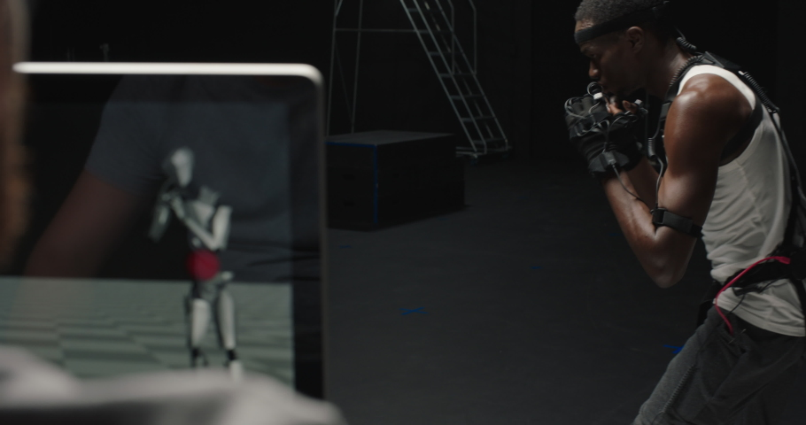 Fit man wearing motion capture suit computer game performing martial arts boxing wearing mo-cap suit for 3d character animation for virtual reality fighting | Shutterstock HD Video #1061018578