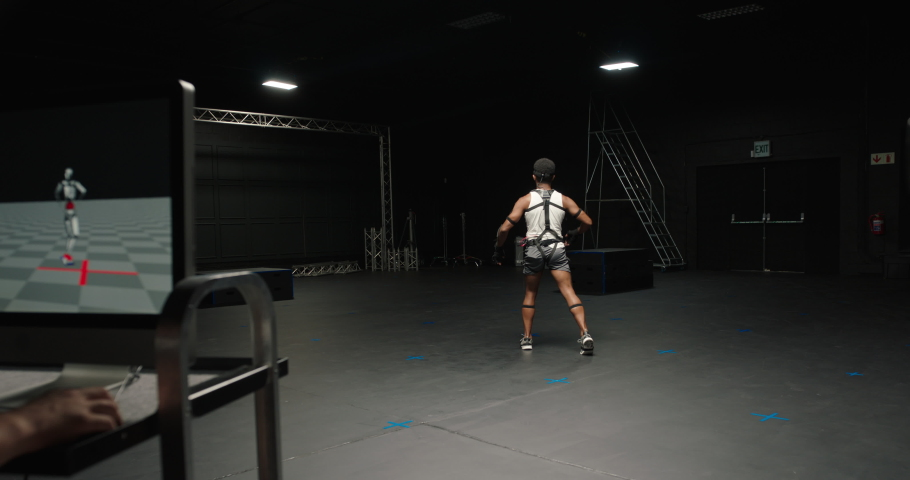 Dancing man wearing motion capture suit in studio actor wearing mo-cap suit for 3d character animation for virtual reality technology | Shutterstock HD Video #1061018596