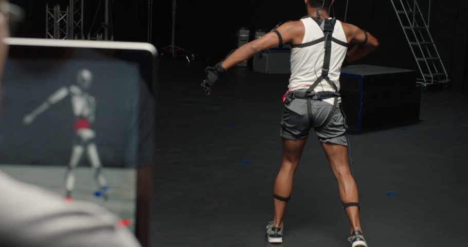 dancing man wearing motion capture suit in studio actor wearing mo-cap suit for 3d character animation for virtual reality technology Royalty-Free Stock Footage #1061018602