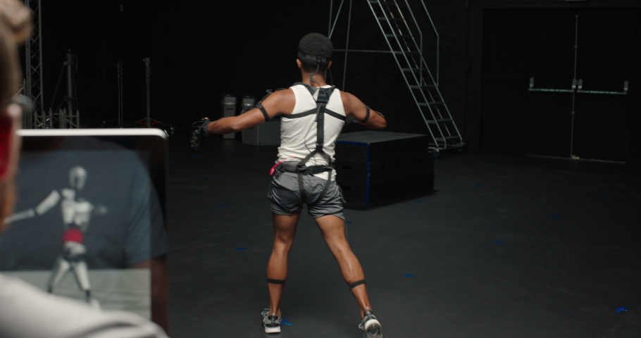 Dancing man wearing motion capture suit in studio actor wearing mo-cap suit for 3d character animation for virtual reality technology | Shutterstock HD Video #1061018608