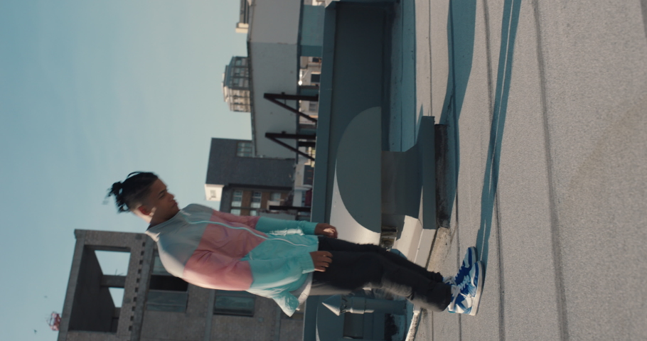 Dancing man breakdancing on rooftop in city hip hop dancer practicing dance routine with hand stand performing freestyle moves in city | Shutterstock HD Video #1061018728