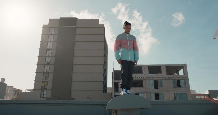 Dancing man jumping somersault breakdancer practicing dance routine on rooftop in urban city | Shutterstock HD Video #1061018746