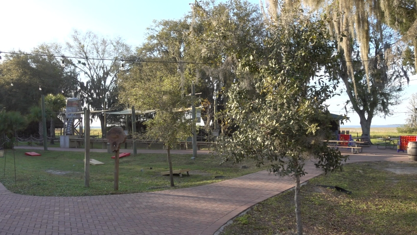 Left To Right Pan Of Outdoor Amusement Park Attractions In Boggy Creek