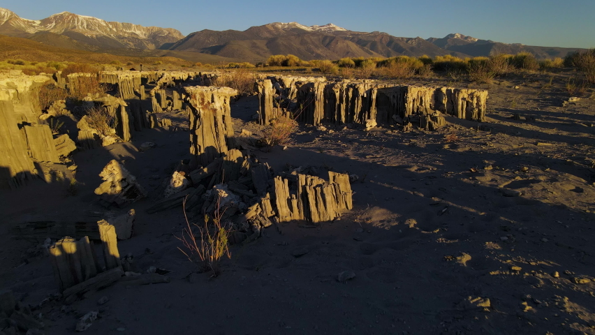 Cinematic aerial shot of Sand Tufas in morning light in Mono Lake, California | Shutterstock HD Video #1061022115