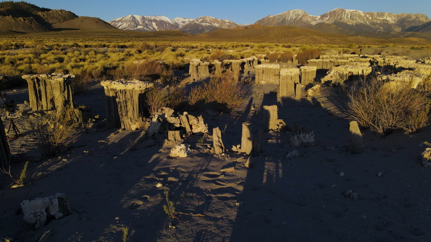 Cinematic aerial shot of Sand Tufas in morning light in Mono Lake, California | Shutterstock HD Video #1061022124