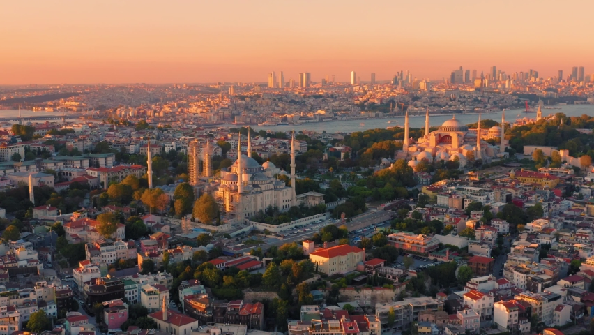 Istanbul, Turkey. Sultanahmet with the Blue Mosque and the Hagia Sophia (Ayasofya) with a Golden Horn on the background at sunset. Aerial view | Shutterstock HD Video #1061023045