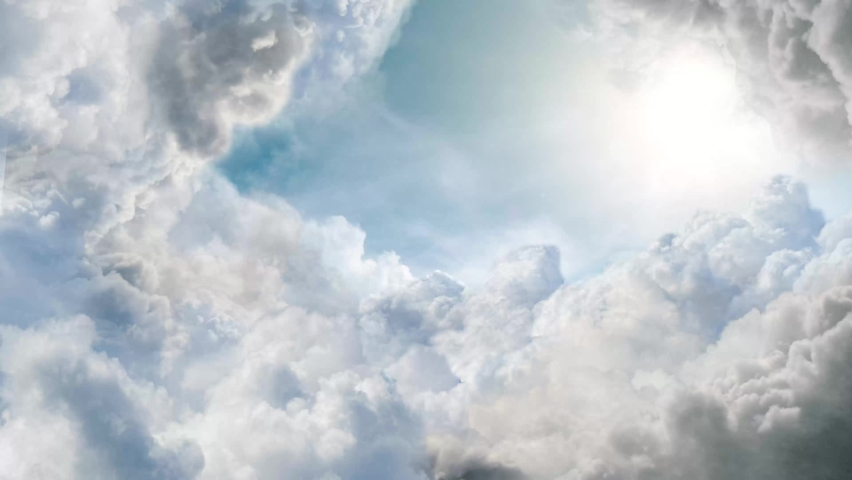 Flying through the beautiful cloudscape. flying in the clouds. Aerial perspective view of flying over clouds.Blue sky with clouds and sun. Royalty-Free Stock Footage #1061031913