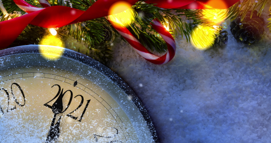 Countdown to midnight. Retro clock counting last moments before Christmas or New Year 2021 next to decorated fir tree. View from above with falling snow. Panning animation Royalty-Free Stock Footage #1061044579