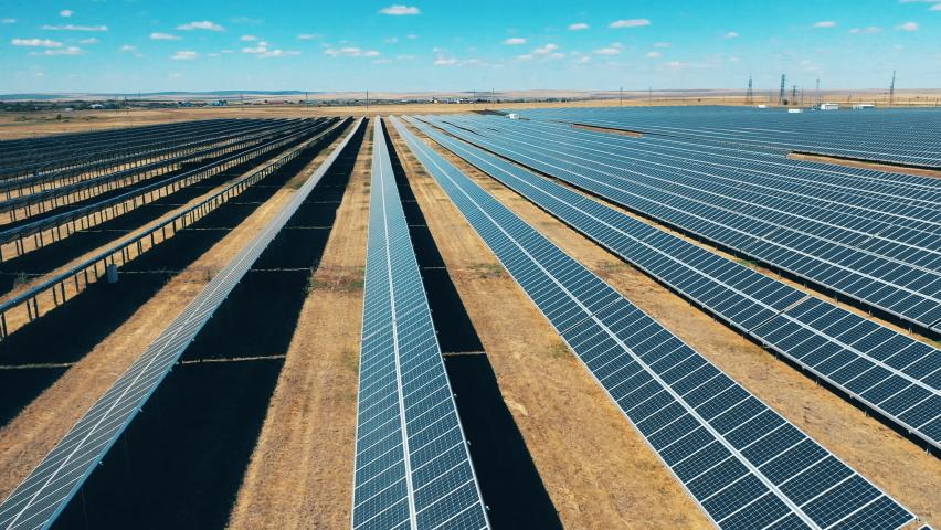 Side view of solar power panels in lines. Solar power, solar panel, solar farm concept. | Shutterstock HD Video #1061050564