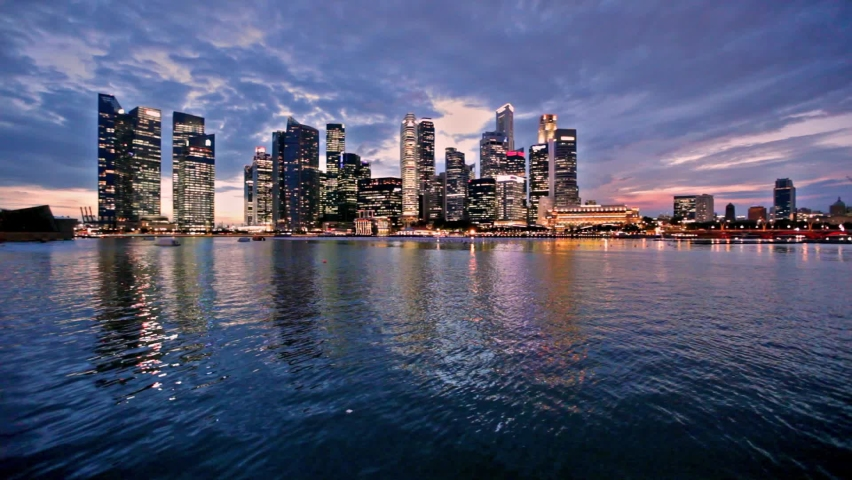 Singapore city skyline at evening with reflection Royalty-Free Stock Footage #1061054710