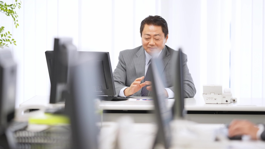 Middle aged asian businessman working in office. Royalty-Free Stock Footage #1061061691