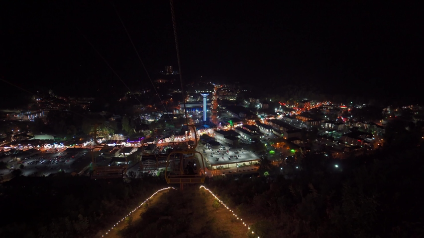 View of Gatlinburg Tennessee at night in the Smokey Mountains . High quality 4k footage. Tourist city in Gatlinburg on autumn night.