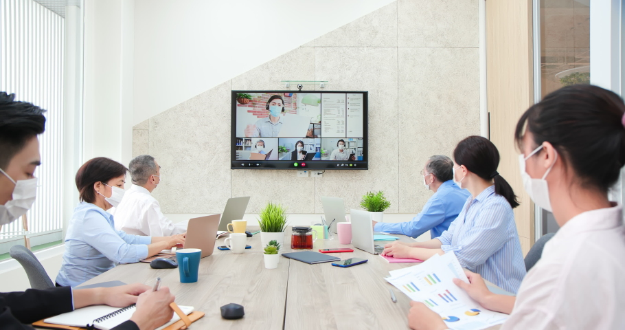 asian teamwork wearing face mask has discussion to inspire creativity about their plan on conference call in office Royalty-Free Stock Footage #1061087236