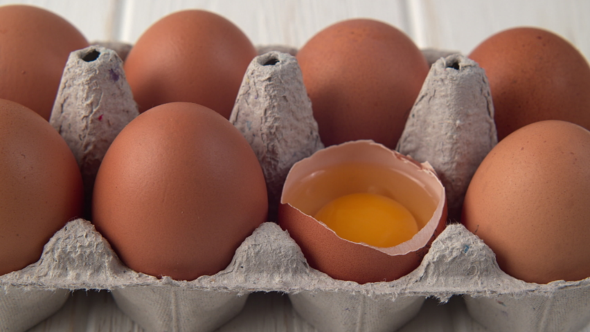 Dolly Shot Chicken Egg in Tray in Zoom View. 4K Prores422 | Shutterstock HD Video #1061098501