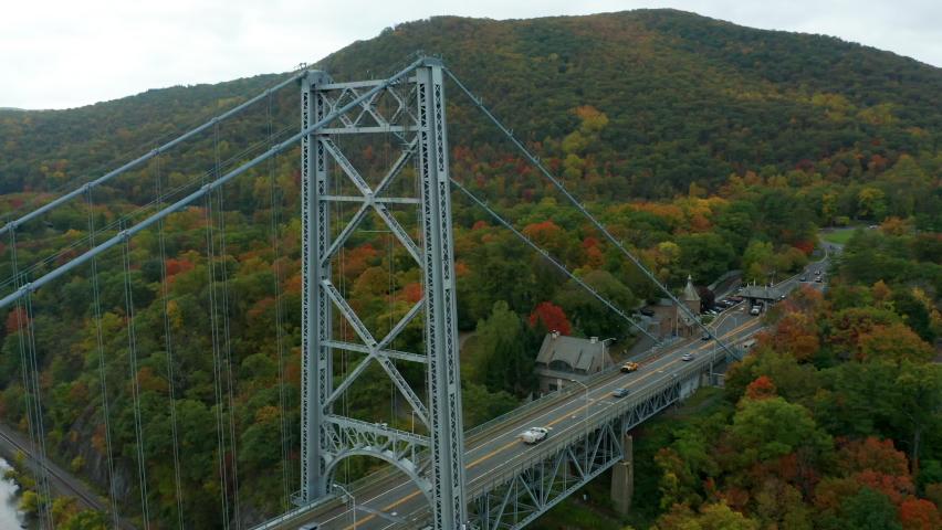 Flying counter clockwise around Bear Mountain Bridge in autumn | Shutterstock HD Video #1061119831