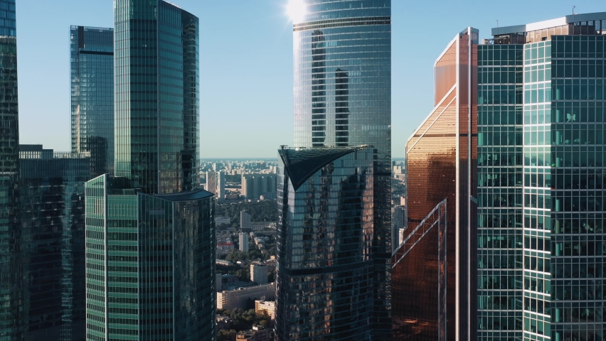 Moscow city glass skyscrapers drone zoom in close to the buildings. Famous Moscow International Business Center sunny evening time, blue horizon line on the background | Shutterstock HD Video #1061126437