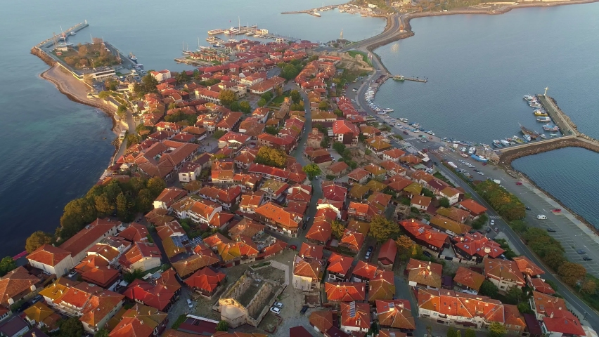 Aerial view of Nesebar old town, Bulgaria. Red tiled roofs of houses in the town of Nesebar. Island where the city is located is washed by the waters of the Black Sea