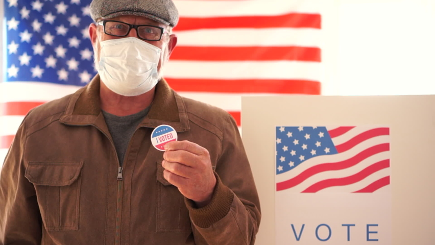 US elections 2020 concept. American retired masked to vote in 2020 US elections. Voting during the Coroanvirus Covid-19 pandemic