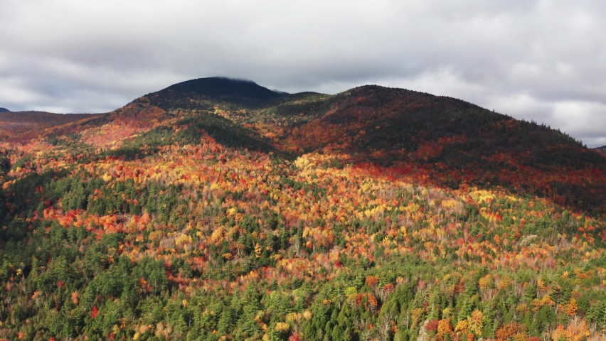 Aerial flythrough of Mountain Forests in Autumn with Fall Colors in Adirondacks, New York, New England | Shutterstock HD Video #1061148826