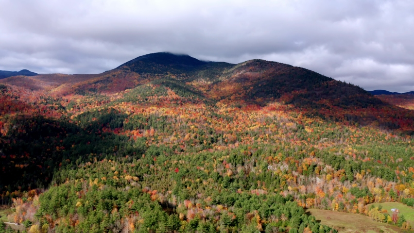Aerial flythrough of Mountain Forests in Autumn with Fall Colors in Adirondacks, New York, New England | Shutterstock HD Video #1061148838