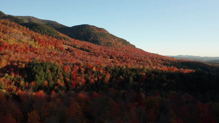 Aerial flythrough of Mountain Forests in Autumn with Fall Colors in Adirondacks, New York, New England | Shutterstock HD Video #1061148847