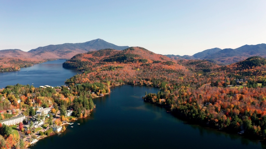 Aerial flythrough over Lake Placid and Mountains during Autumn Fall Colors in Adirondacks, New York, New England, USA | Shutterstock HD Video #1061148850