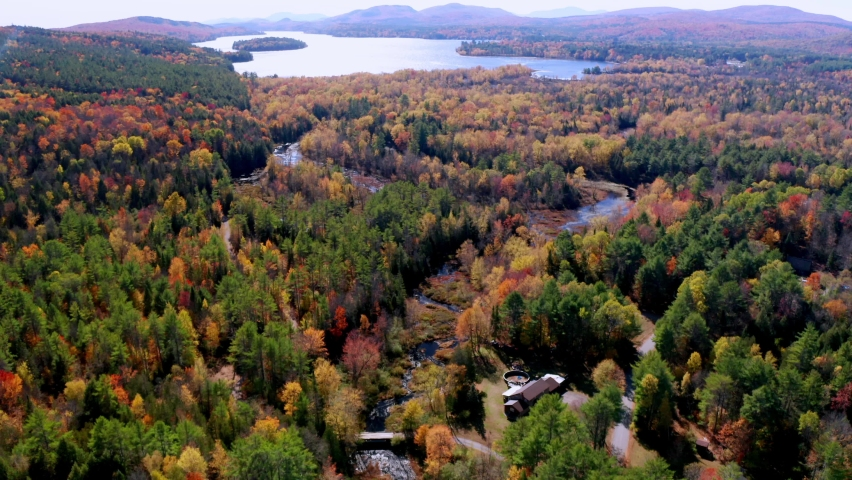 Aerial flythrough of Winding River Through Autumn Trees with Fall Colors in Adirondacks, New York, New England, USA | Shutterstock HD Video #1061148874