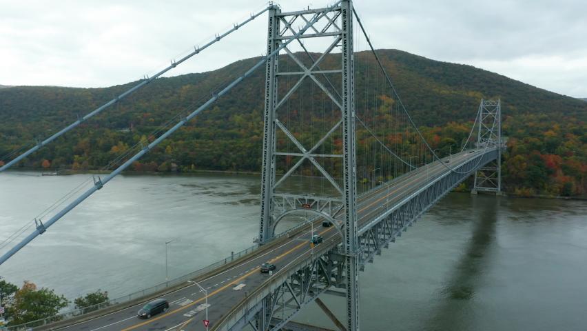 Flying west alongside Bear Mountain Bridge in autumn | Shutterstock HD Video #1061153182