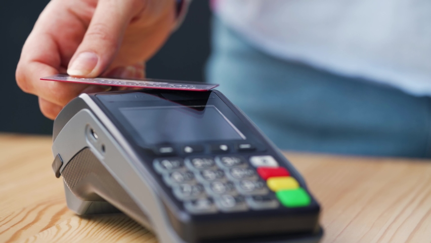 NFC credit card payment. Woman paying with contactless credit card with NFC technology. Wireless money transaction. Wireless payment Royalty-Free Stock Footage #1061154604