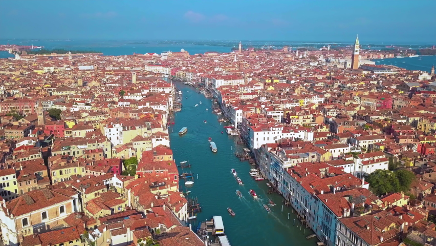 Aerial drone video of iconic and unique Grand Canal crossing city of Venice as seen from high altitude, Italy. | Shutterstock HD Video #1061161027